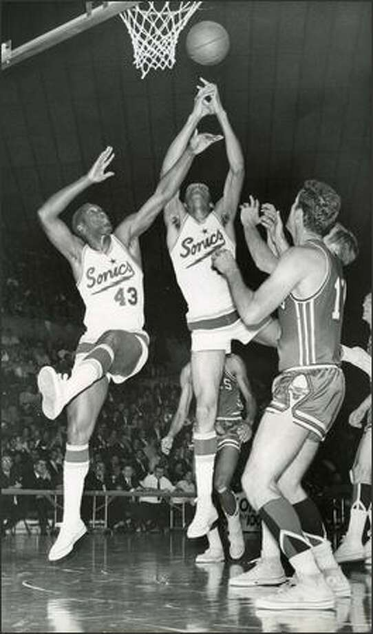1967: Seattle Supersonics players Plummer Lott and Bob Rule go for a rebound against Chicago. Photo: Seattle Post-Intelligencer