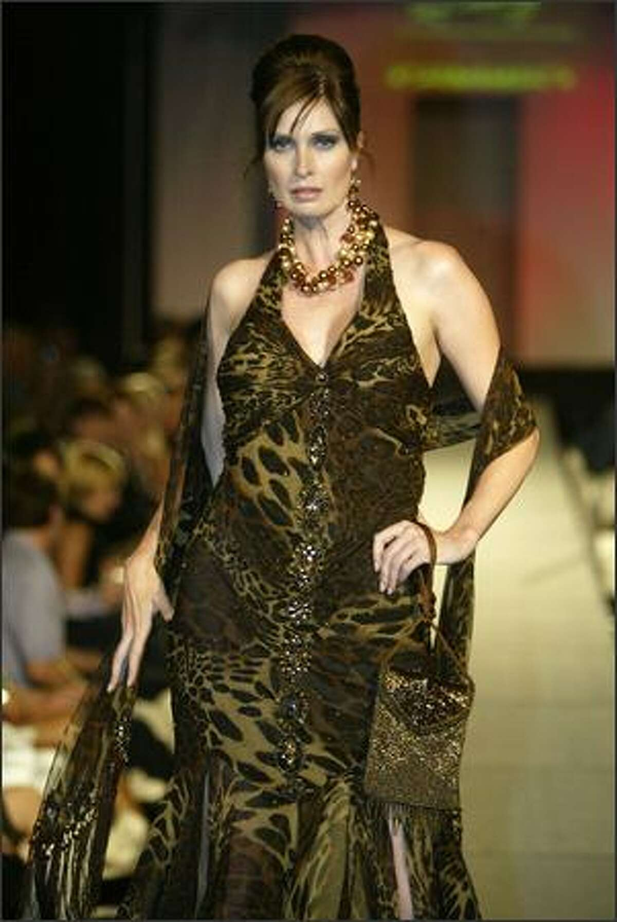 A model shows an outfit from Karan Dannenberg Clothier: Sue Wong Leopard dress, Sue Wong shawl, Susan Marsh copper necklace and shoes by Shoefly at the fall 2006 Fashion First runway show, held at the Premier night club in Sodo on Thursday, Aug. 3.
