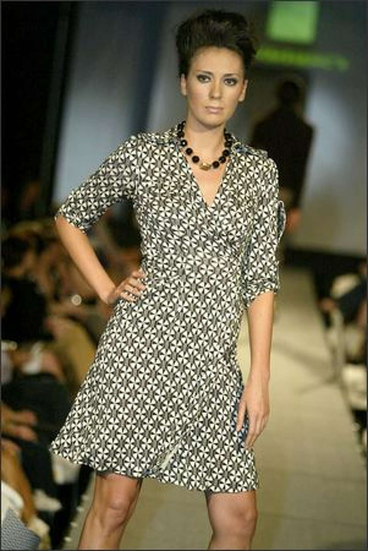 A model shows an outfit from Canopy Blue: Diane von Furstenberg utility wrap dress with jewelry by Juliet Roger.