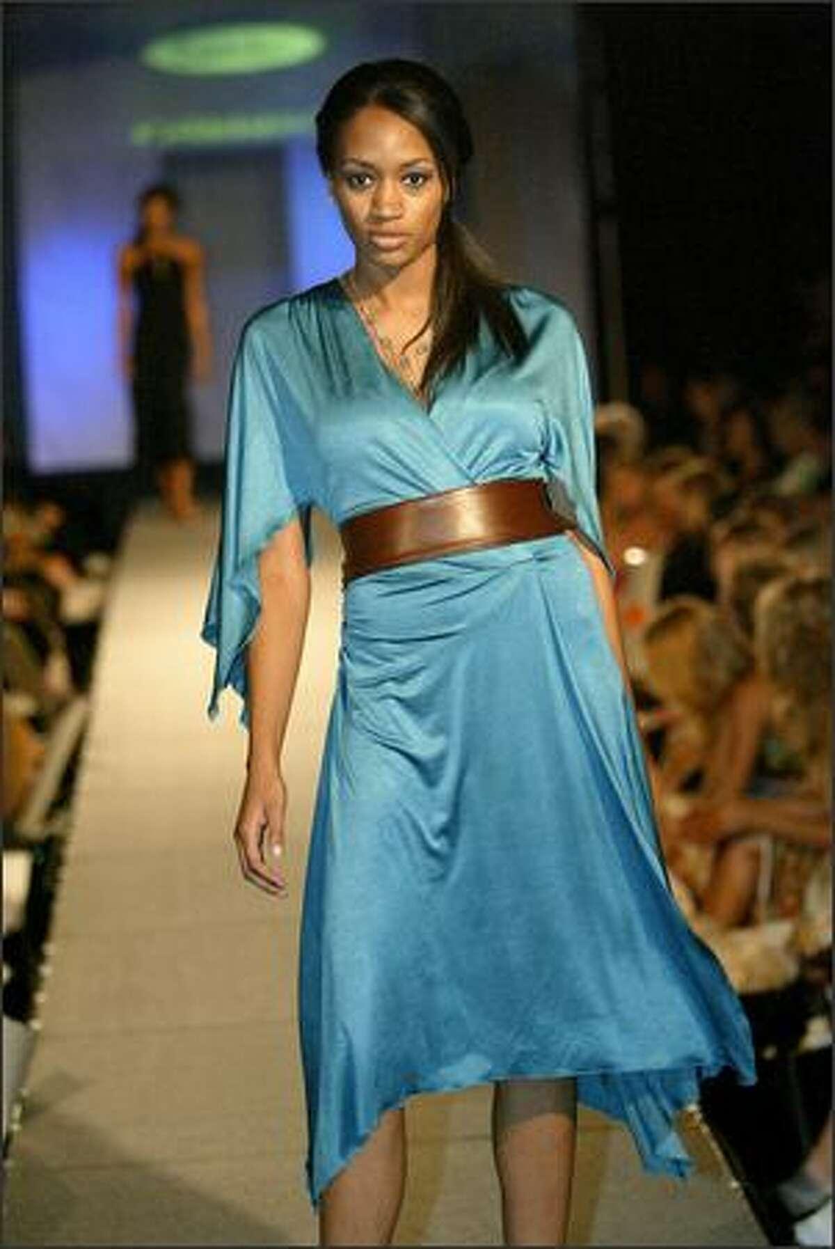 A model shows an outfit from Carmilia's: Black Halo kimono dress, Black Halo leather obi belt and Sara Pauli necklace.