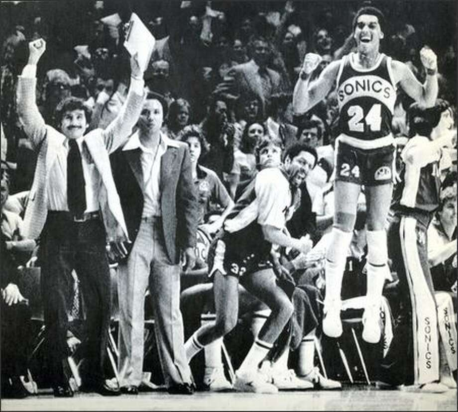 1979: From left, SuperSonics assistant coach Les Habegger, head coach Lenny Wilkens, team captian Fred Brown and Dennis Johnson celebrate as their championship win over the Washington Bullets neared. Photo: Seattle Post-Intelligencer