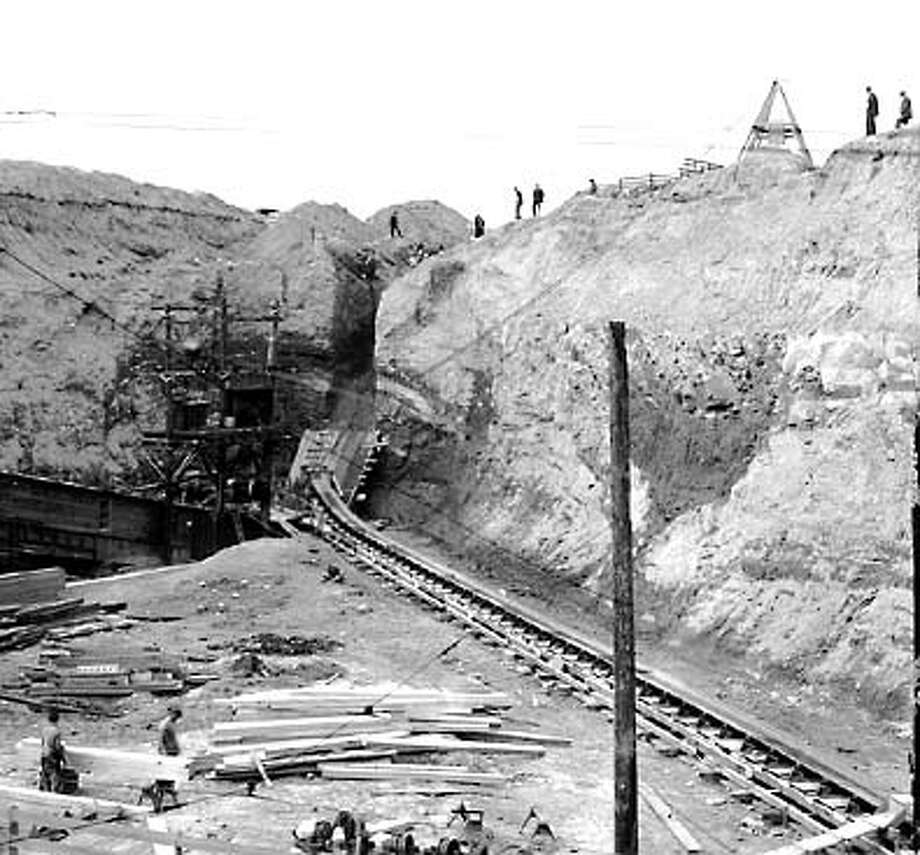 "At the time, the Seattle Post-Intelligencer referred to the regrade as ""one of the great engineering projects of the West."" Steam shovels and water sluices ate away at the hillside and conveyor belts carried the dirt to the waterfront for disposal. Photo: Seattle Post-Intelligencer"