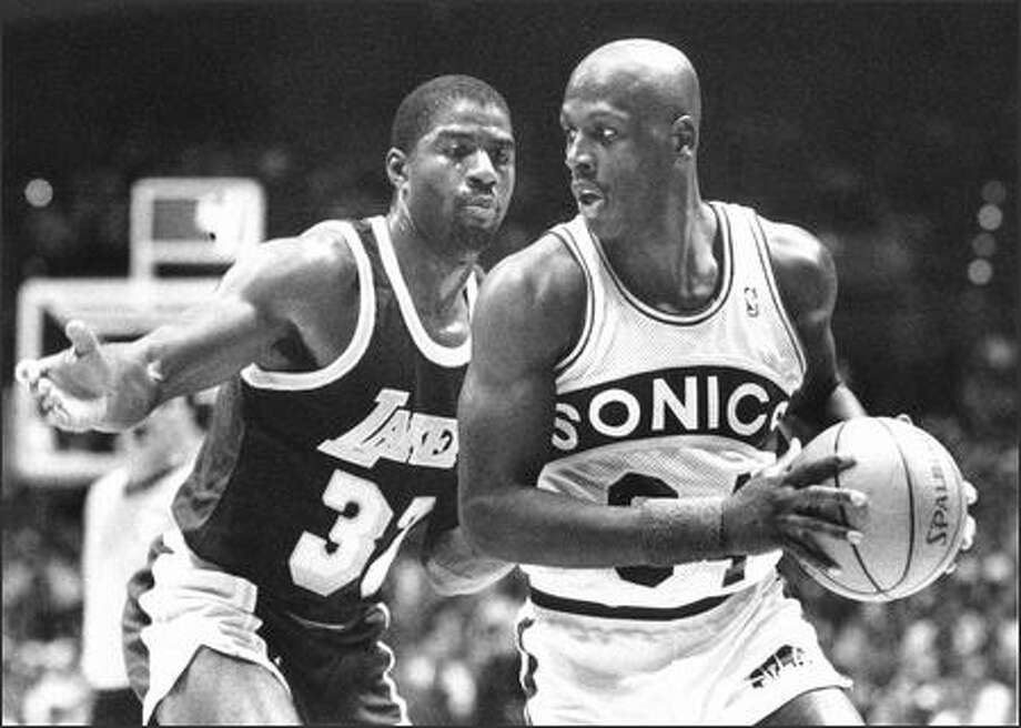 1988: Seattle SuperSonic Xavier McDaniel shown with Los Angeles's Earvin Johnson. Photo: Seattle Post-Intelligencer