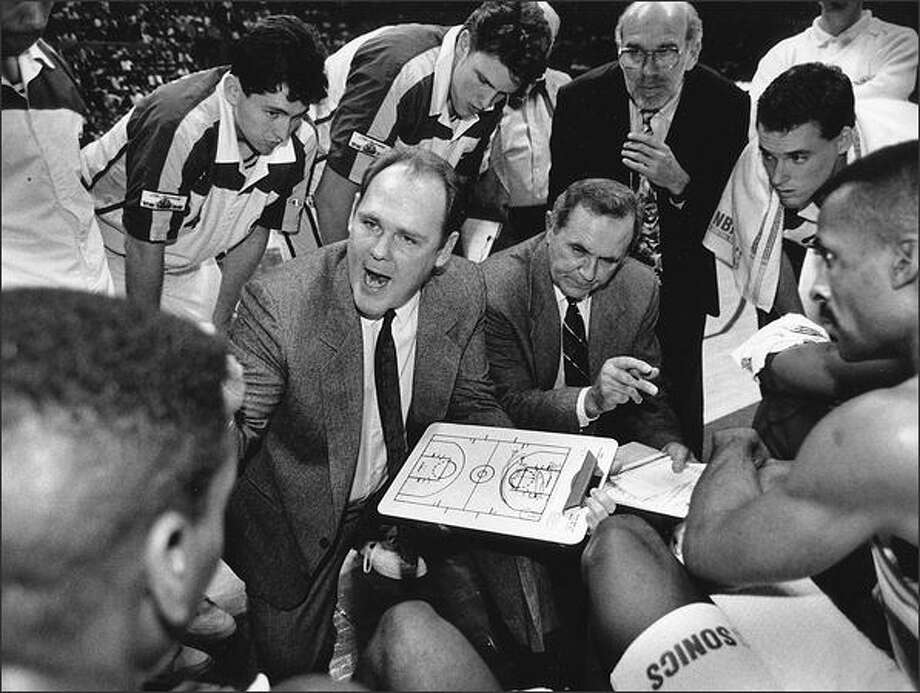 George Karl, clipboard in hand, yells out instructions during a timeout in his first game as Sonics coach on Jan. 23, 1992. The Portland Trailblaziers ruined his debut, beating Seattle 113-109.