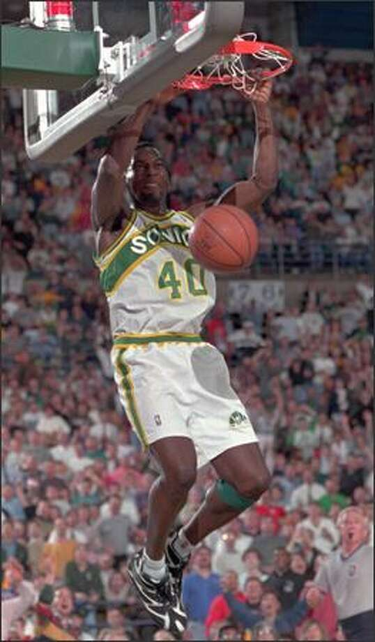 Shawn Kemp (40) of the Seattle SuperSonics jams the ball on a fast break for two of his 21 points during Thursday's, April 27, 1995, NBA playoff game in Tacoma, Wash., against the Los Angeles Lakers. Seattle beat Los Angeles 96-71 to take a 1-0 lead in the best of five, first round series. (AP Photo/Bill Chan)