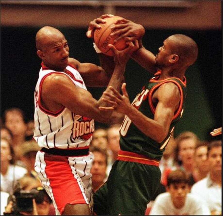 Clyde Drexler and Gary Payton battle for the ball in the first quarter of action during the 4th playoff game in Houston, 5/12/96. Seattle swept the series 4-0. Photo by Mike Urban