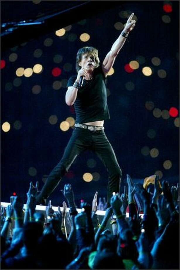 Rolling Stones singer Mick Jagger plays to the halftime crowd. Photo: Dan DeLong, Seattle Post-Intelligencer