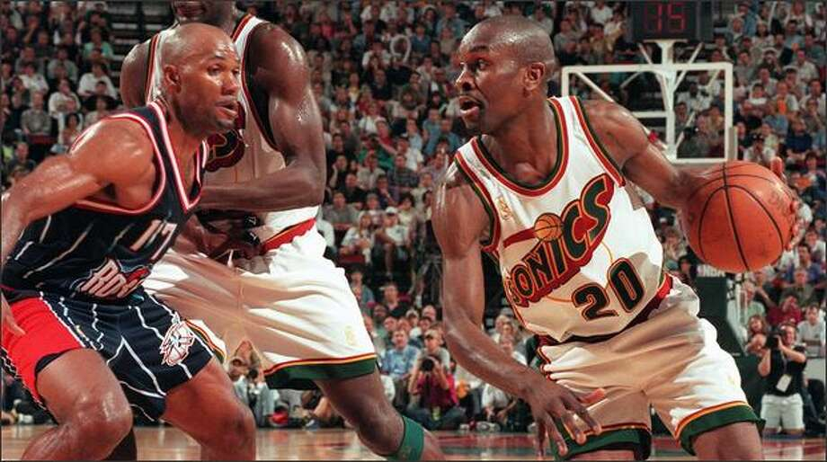 Seattle Supersonics Gary Payton drives around Houston Rockets Mario Elie (17) as Shawn Kemp sets up a pick. Photo by Grant M. Haller 5/15/97