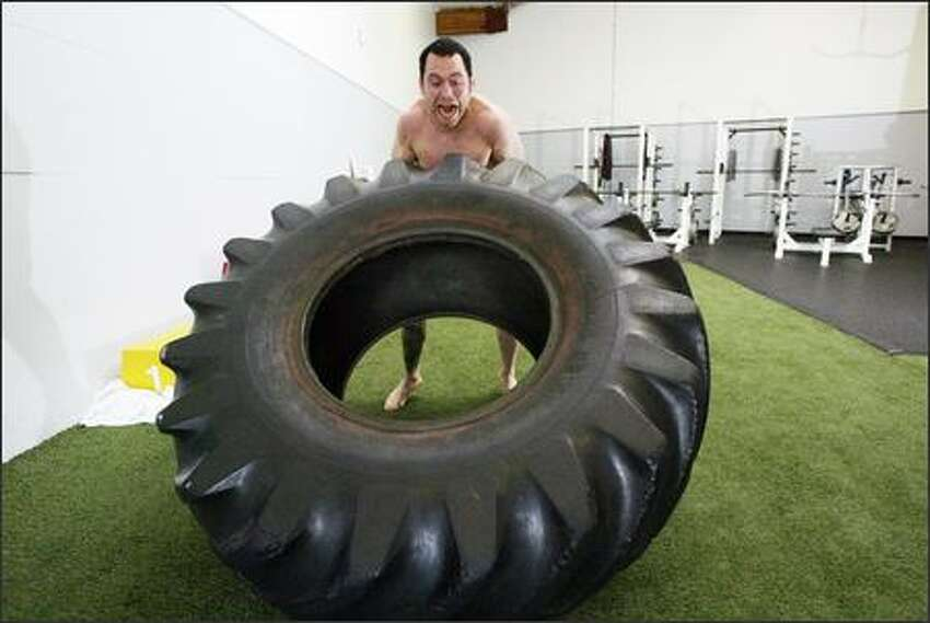 Ultimate fighter Chris Leben conditions using a 300-pound tractor tire in Kirkland.