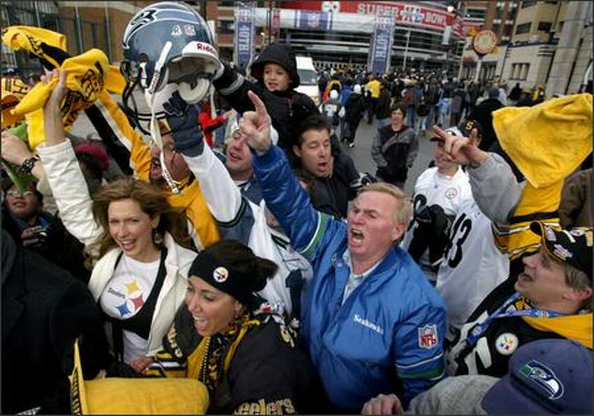 Seahawks fan Larry Beagley of Olympia shows his spirit while surrounded by Steelers fans outside Ford Field.