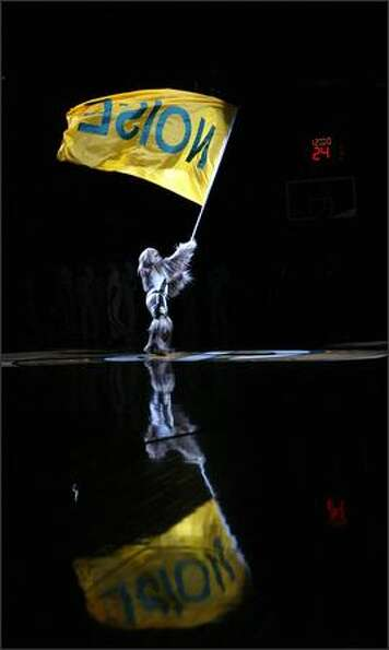 Squatch flies a flag before the start of the Sonics' game against the Charlotte Bobcats in the 2006-