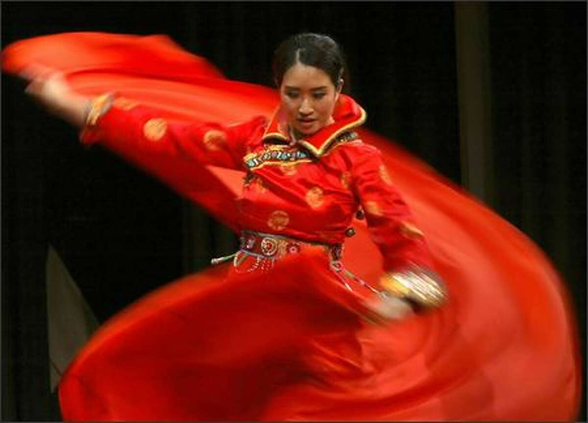 Tiffany Wan is a blur of motion as she performs a traditional Mongolian dance during the creative expression presentations at the 2006 Miss Seafair coronation Tuesday in Seattle.