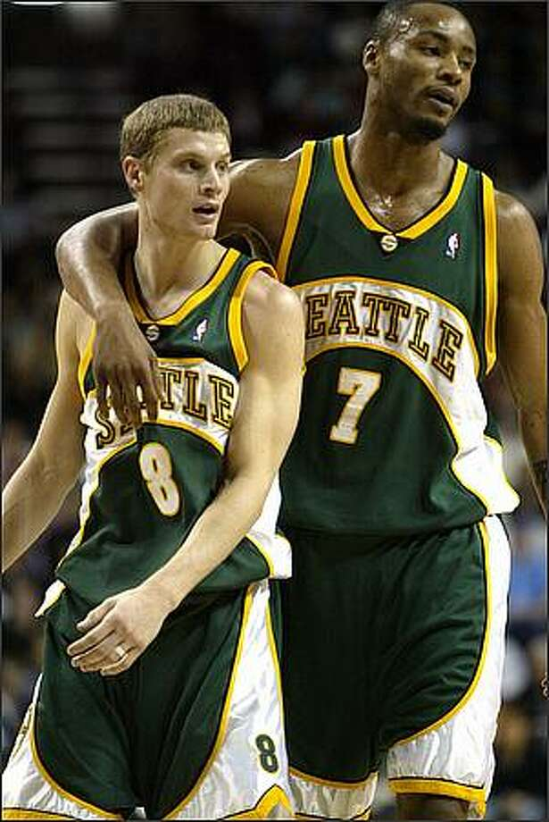 Luke Ridnour and Rashard Lewis hug after a play against the Philadelphia 76ers in 2006 at Key Arena. (P-I photo by Joshua Trujillo)
