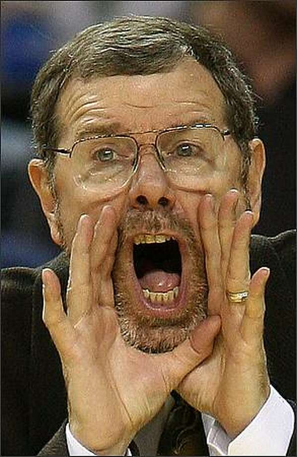 SuperSonics head coach P.J. Carlesimo yells instructions to his team during in 2007. (P-I photo by Mike Urban)