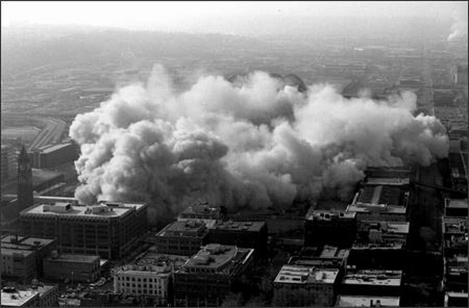 Fourth of four photos of the Kingdome implosion. Photo: Phil H. Webber, Seattle Post-Intelligencer