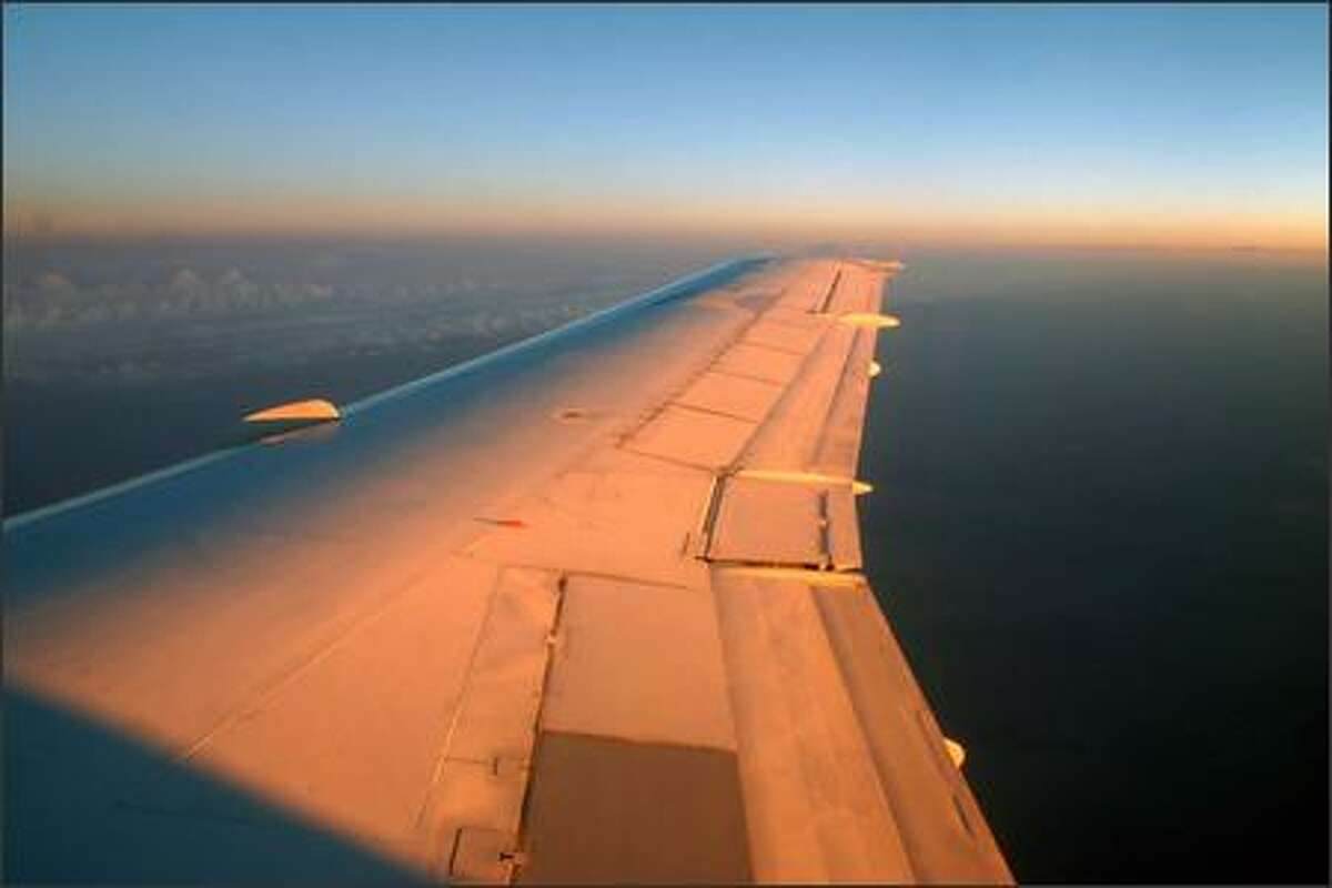 Sunset reflects off the wing of our plane on the flight from Italy to Kazakhstan. (PHOTO COURTESY OF GEOFFREY THOMAS)
