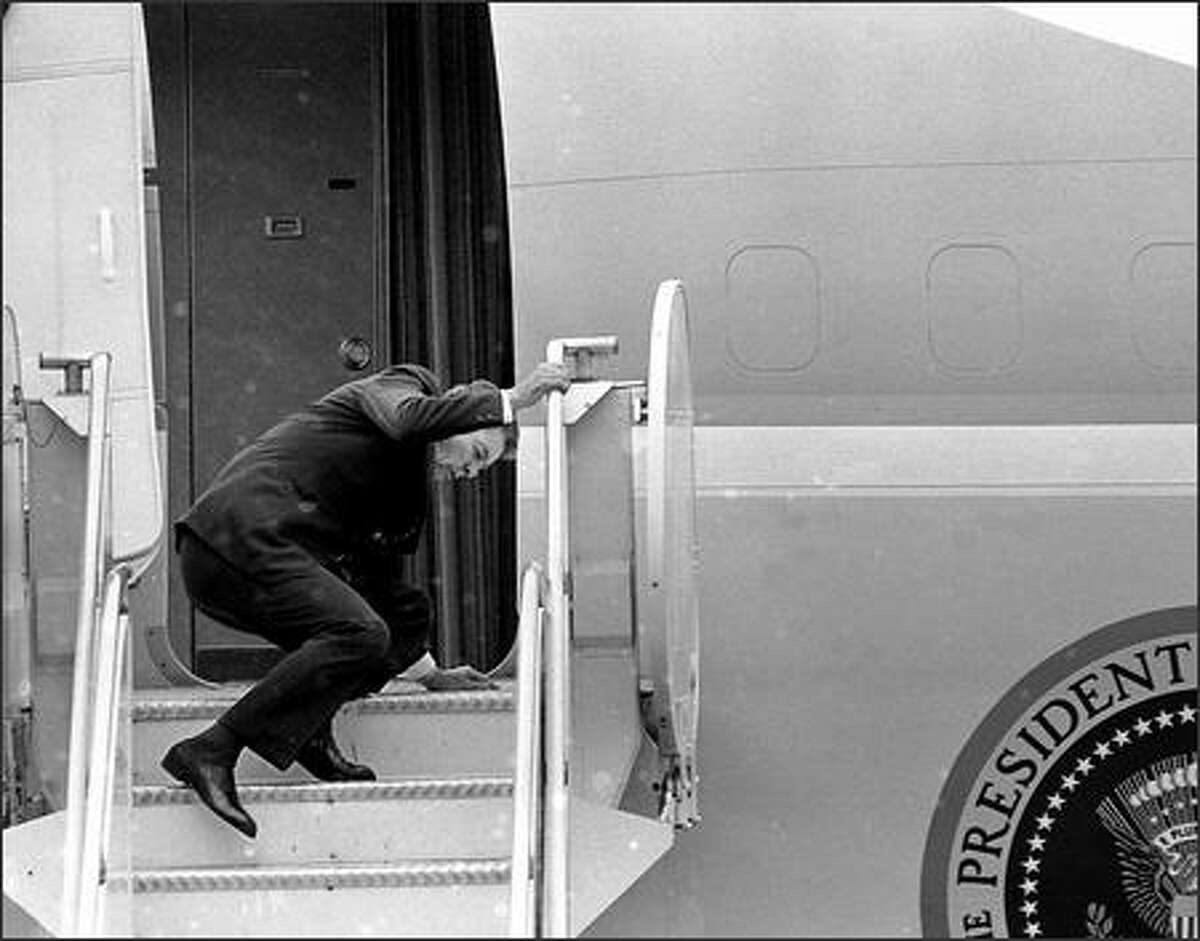 President Ronald Reagan slips on the steps of Air Force One at King County International Airport after a visit to Seattle.