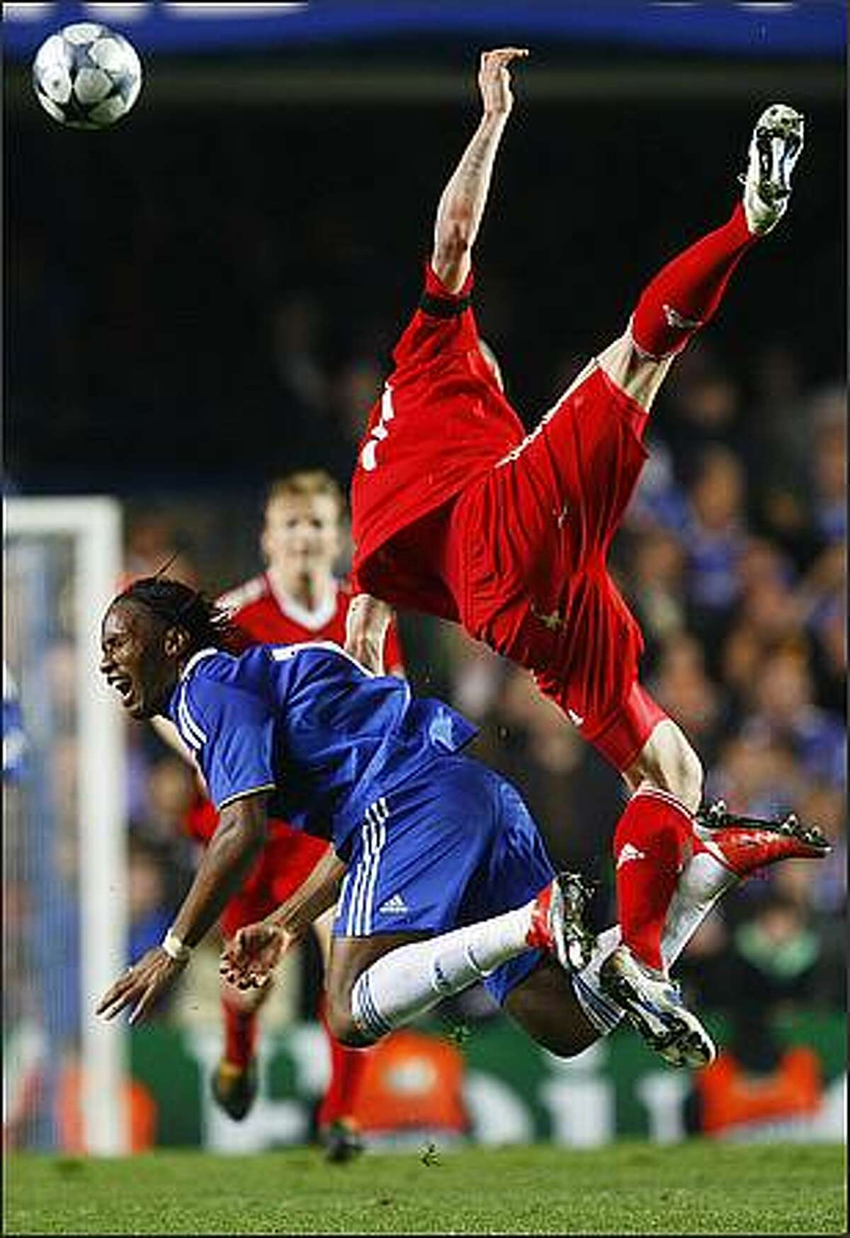Chelsea's Didier Drogba, left, is fouled by Liverpool's Martin Skrtel during their Champions League quarter-final second-leg soccer match at Stamford Bridge in London on April 14.