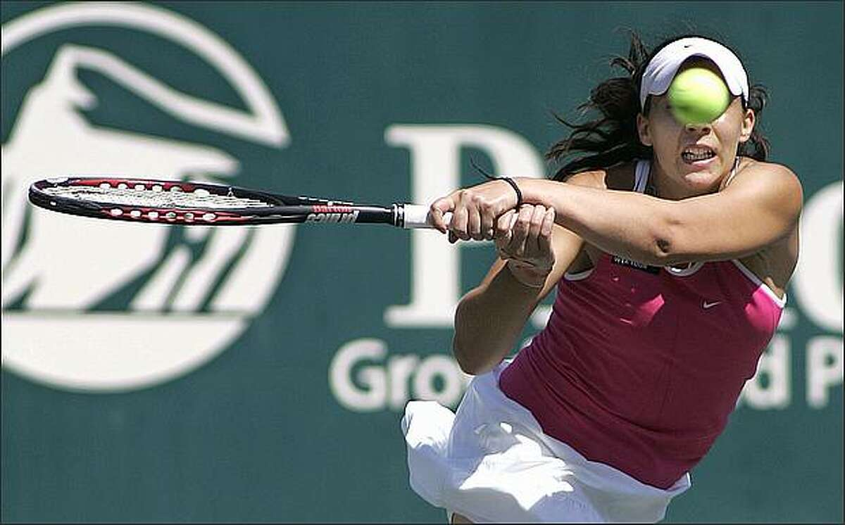 Marion Bartoli of France returns a volley during her women's tennis match against Melanie Oudin of the U.S. at the Family Cup Circle Tennis Tournament in Charleston, S.C., on April 16.