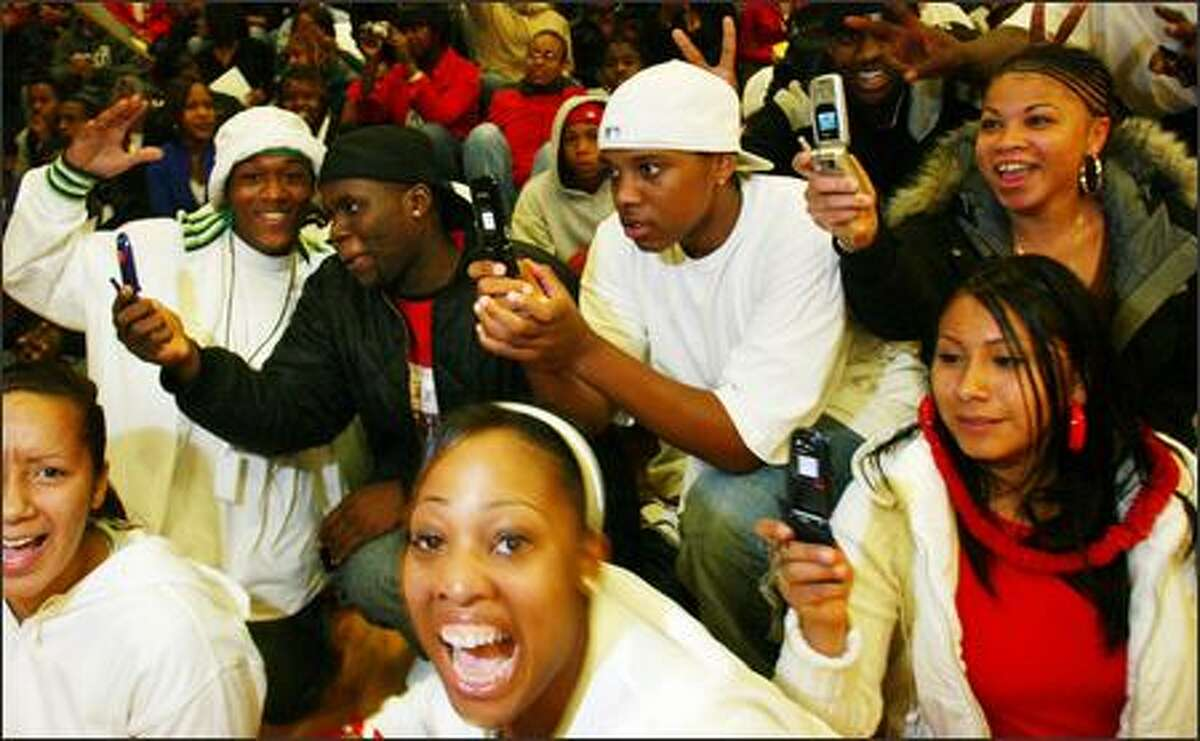 Students go wild and take pictures with their cell phones when Sonics players Ray Allen and Rashard Lewis appear in the gym at Cleveland High School in West Seattle.