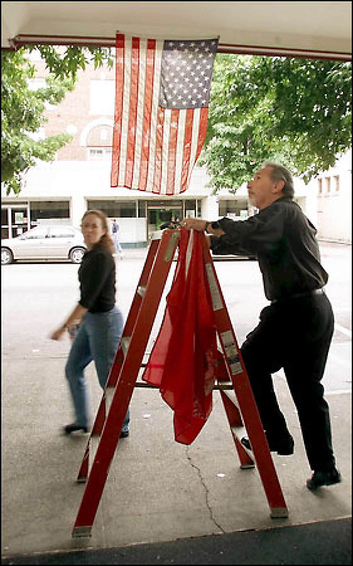 """""""I expect my customers to salute the flag before they can come in,"""" Barber Cap DeMiero, a former Marine, says."""