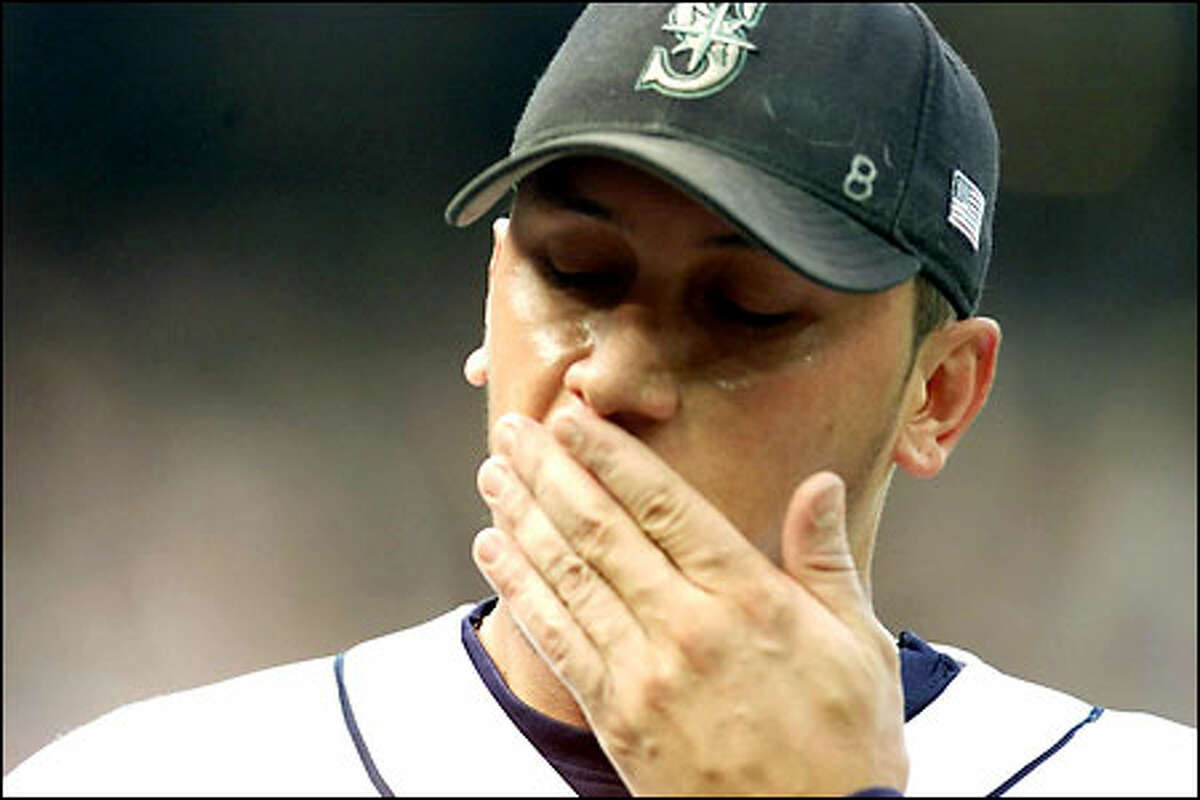 Freddy Garcia reacts after giving up three runs in the forth inning.