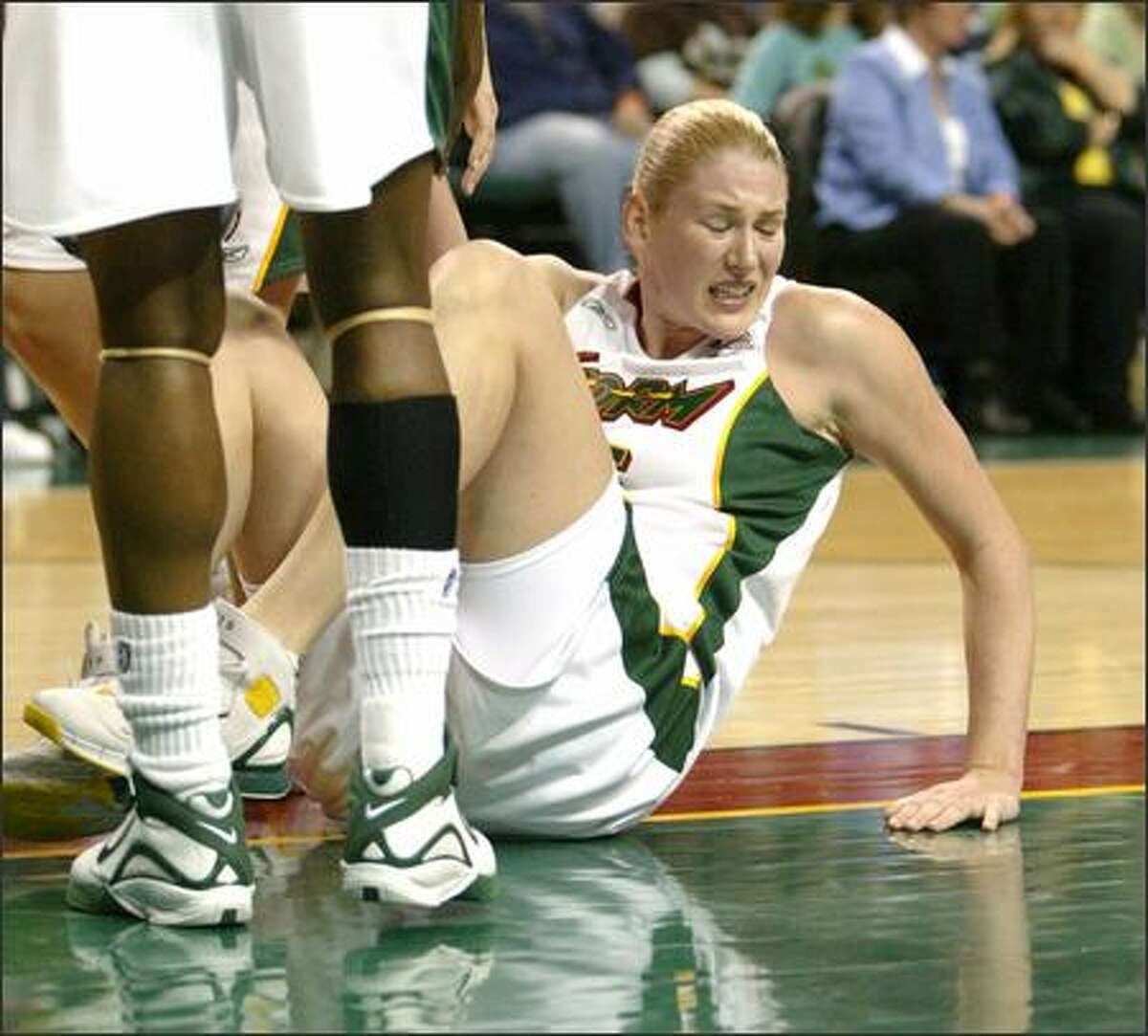Lauren Jackson reacts after getting hammered by the Los Angeles Sparks' Christi Thomas.