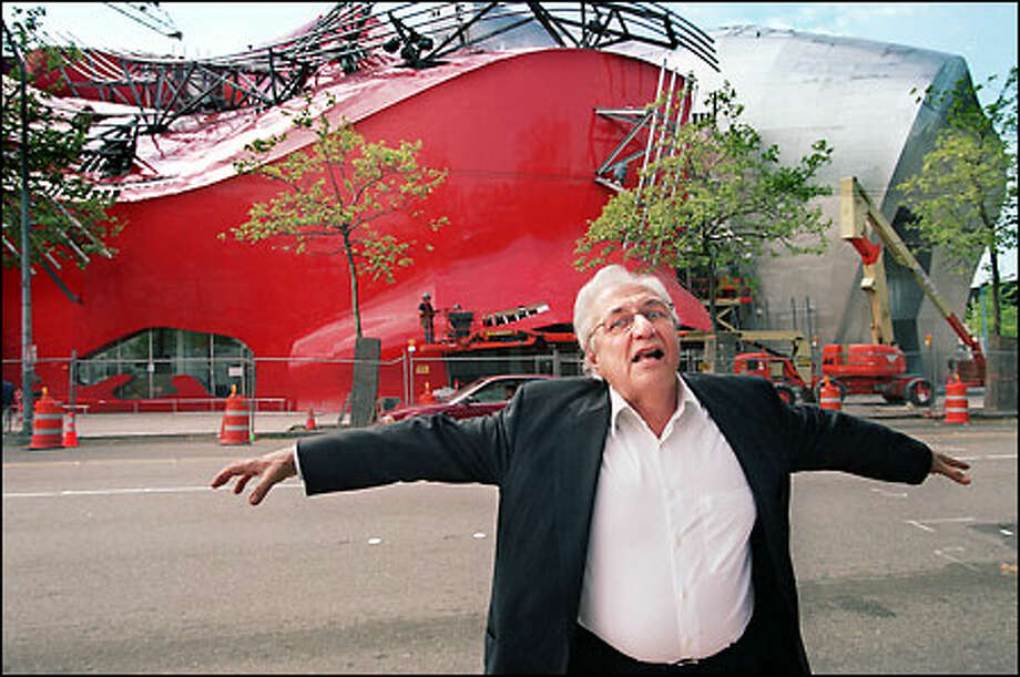 A MONUMENT TO ROCK'N ROLL, 2000: Iconoclastic architect Frank Gehry cavorts in front of the Experience Music Project, the music museum he designed at the Seattle Center, financed by Paul Allen. The museum is an example of the impact the city's high-tech entrepeneurs are making. Photo: Renee C. Byer, Seattle Post-Intelligencer
