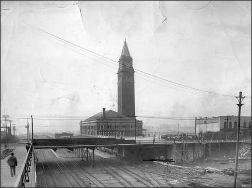 Union Depot photographed from the northeast (date unknown).Trains first began rolling through the station on May 10, 1906, at a time when the three-story King Street Station and its 245-foot tower, modeled after the Piazza San Marcos in Venice, were still being finished.