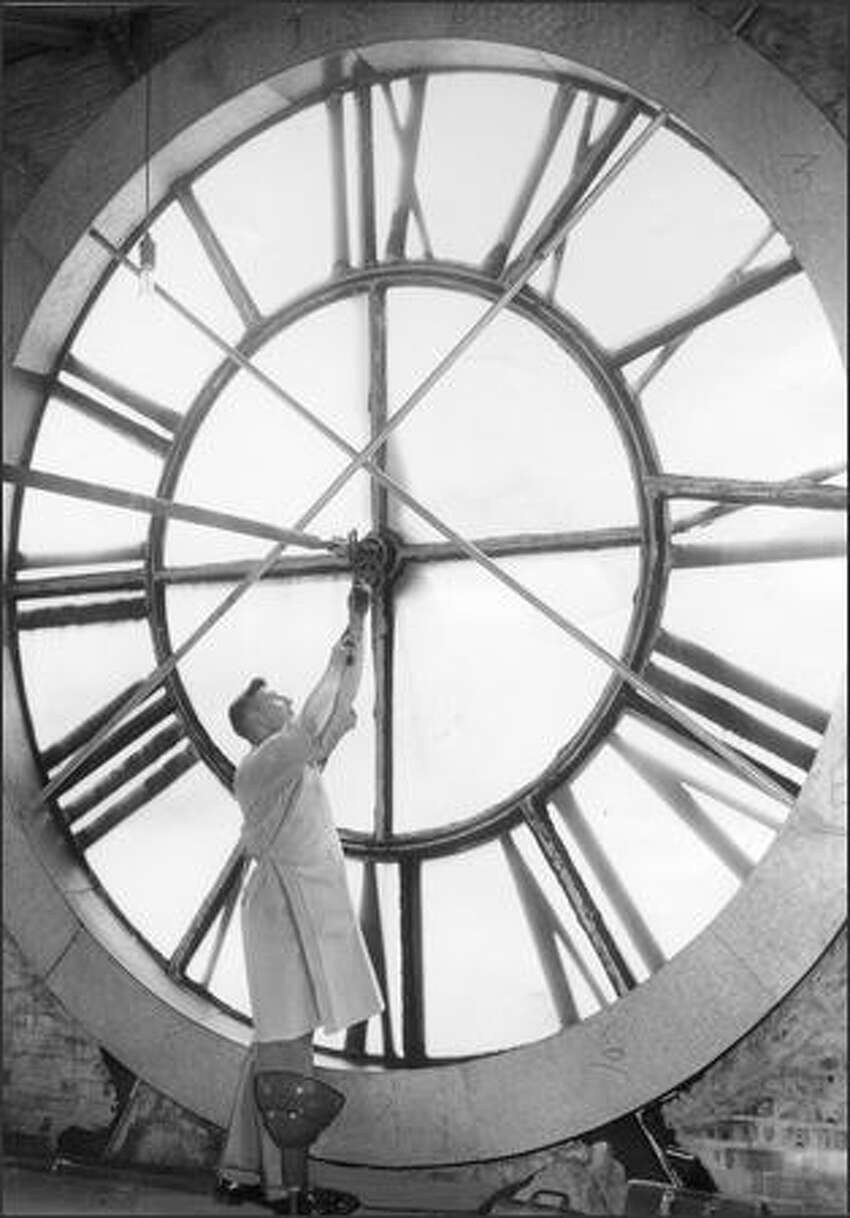 W.L. Wilson of IBM adjusts the clock at King Street Station on May 24, 1957.Many area residents have memories of King Street Station, and they'll be sharing them in an eight-week celebration of its history that begins at noon Wednesday, May 10, 2006, with a panel discussion in the Bertha Knight Landes Room at Seattle City Hall, 600 Fourth Ave.