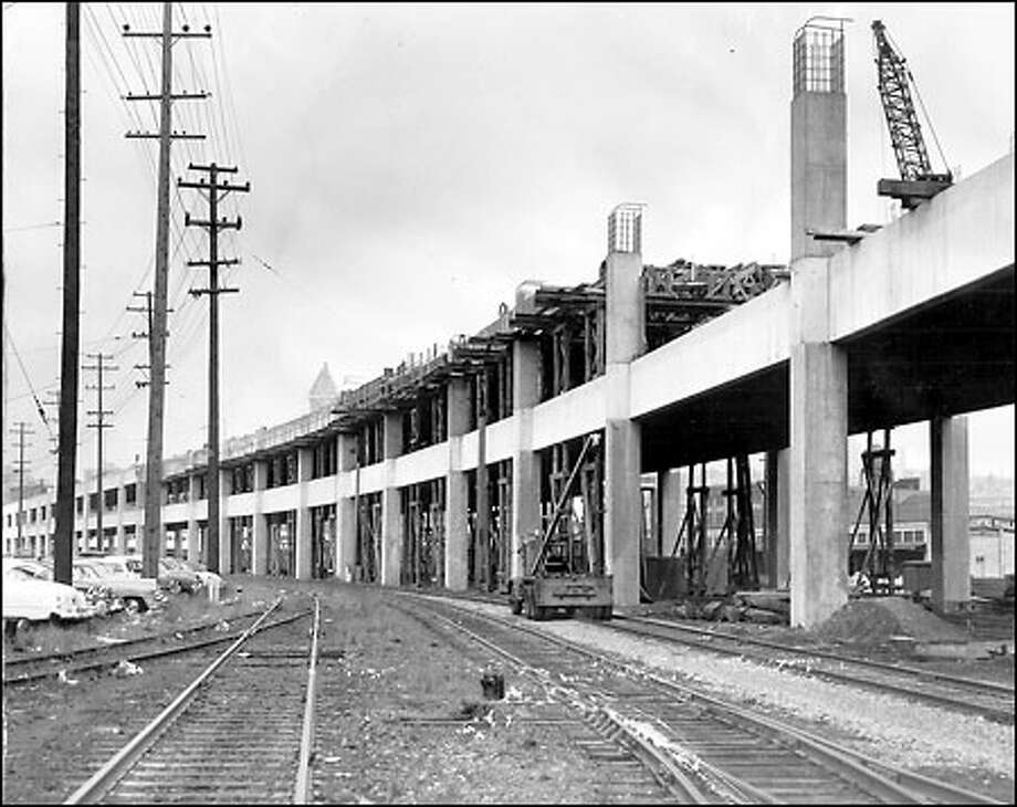 "Extension of the Alaskan Way Viaduct, 1957: Initially terminating at the south end of Pioneer Square in 1953, the Alaskan Way ""Sea Wall"" -- as it was called by some opponents -- is 60 percent complete in this photo. Photo: Seattle Post-Intelligencer"