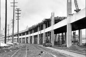 """Extension of the Alaskan Way Viaduct, 1957: Initially terminating at the south end of Pioneer Square in 1953, the Alaskan Way """"Sea Wall"""" -- as it was called by some opponents -- is 60 percent complete in this photo."""