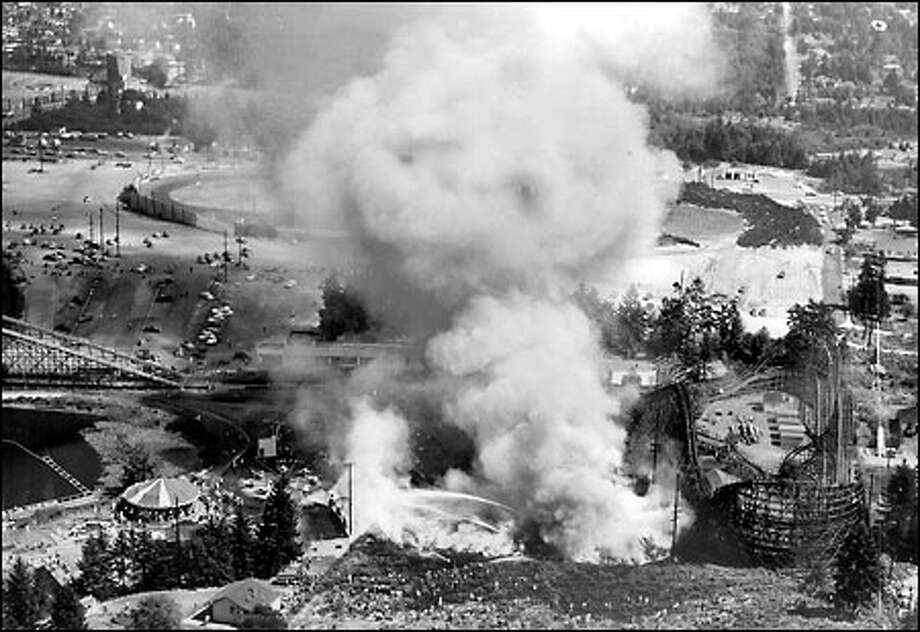 Playland fire, 1953: Among Seattle's longstanding attractions, Playland at Bitter Lake drew crowds to its carousel, roller rink, fun house, log chute and Big Dipper roller coaster, at right, between 1930 and 1961, when the amusement park closed. Several large fires hit the amusement park during its decades of operation. Photo: Seattle Post-Intelligencer