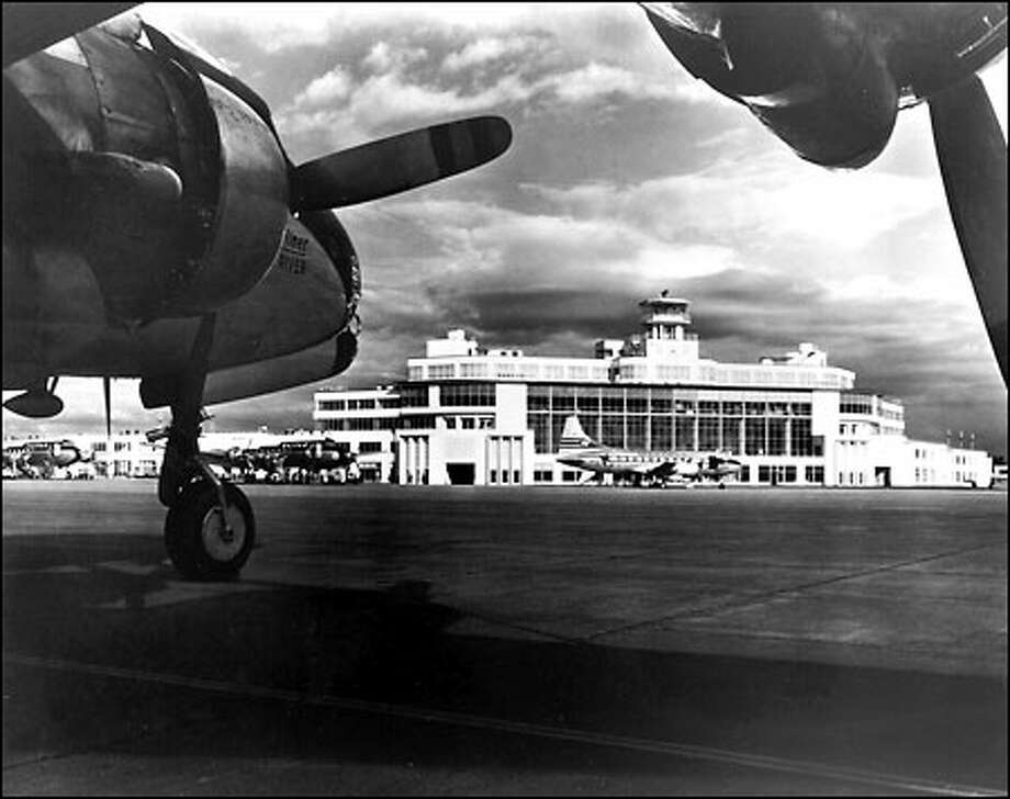 Sea-Tac Airport, c. 1950: A Western Airlines Convair 240, background right, and two United Airlines DC-4s park near the new terminal at Sea-Tac. Another United DC-4 is in the foreground. When the terminal opened July 9, 1949, the 5-year-old airport began full civilian operation. Sea-Tac was initially used by the military. Photo: Seattle Post-Intelligencer