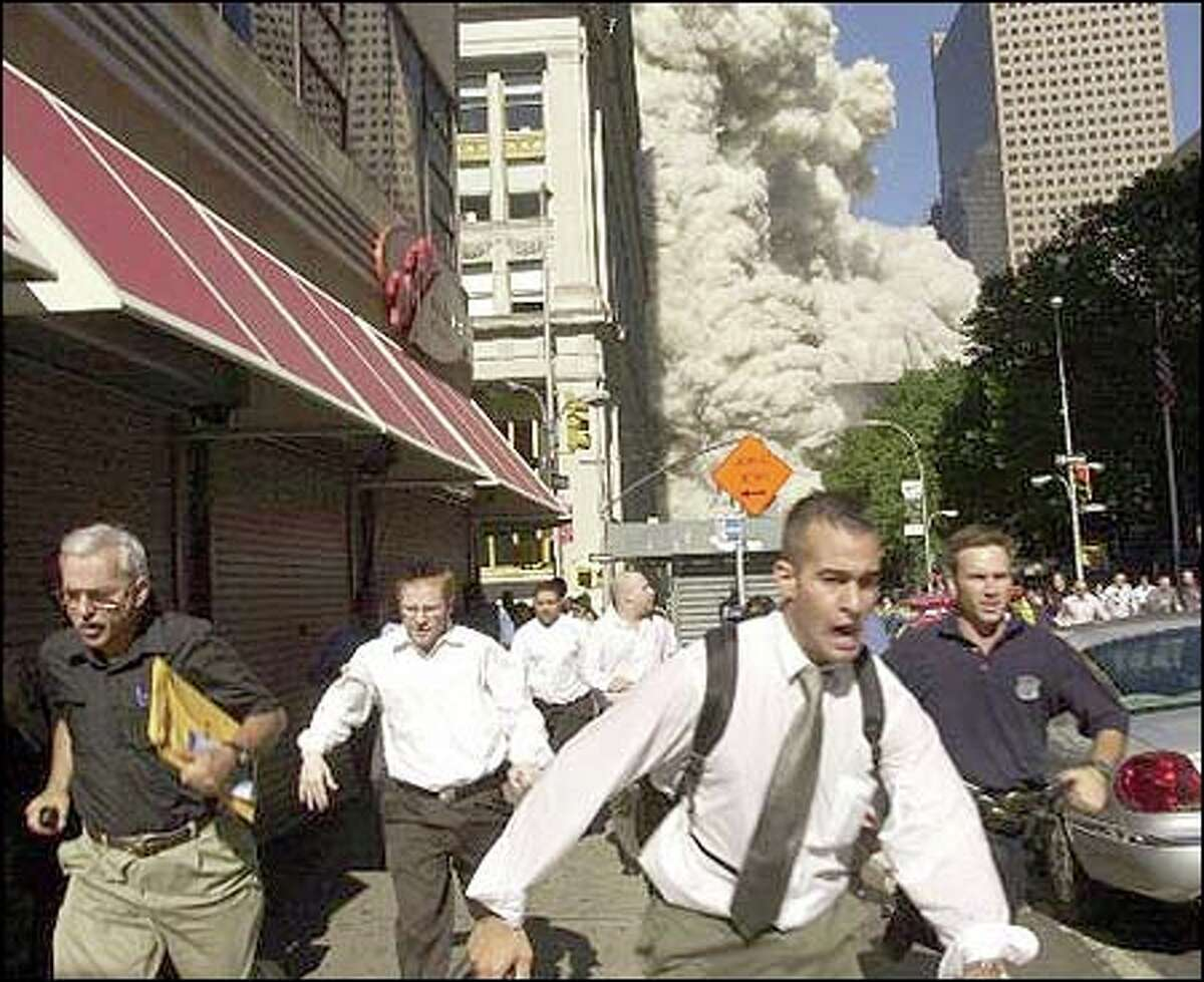 People run from the collapse of the World Trade Center in New York on Sept. 11, 2001.