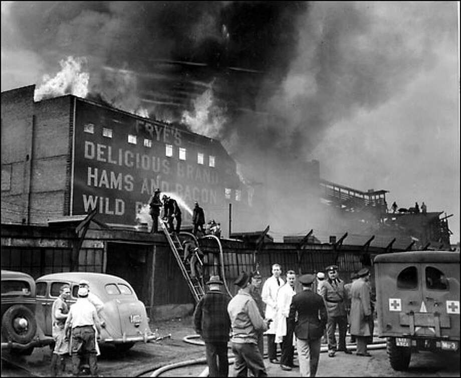 Seattle's deadliest fire, 1943: A Boeing prototype XB-29 bomber crashed into the Frye Packing plant Feb. 18, 1943, killing all 11 crew members and 19 workers on the ground. Test pilot Eddie Allen had reported an engine fire and fought to return to Boeing Field, but the plane crashed into the plant on Airport Way. Photo: Seattle Post-Intelligencer