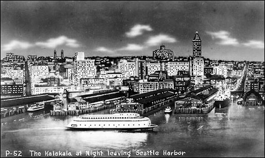 The gleaming Seattle waterfront: The ferry Kalakala cruises past the Seattle waterfront in this undated, stylized photo postcard donated courtesy of Ilene Kearnes of Federal Way. Until the era of skyscrapers, the skyline was dominated by the L.C. Smith Tower at right – the tallest structure west of the Mississippi when it was completed – and the clock tower of the old Colman Dock to the left on the waterfront. Photo: Seattle Post-Intelligencer
