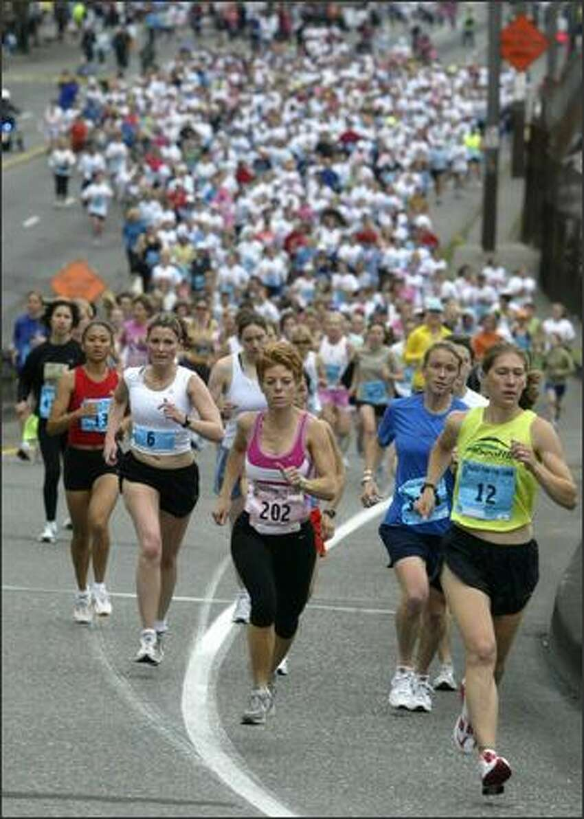 Runners in the Women's 5K event at the Susan G. Komen Breast Cancer Foundation Puget Sound Race for the Cure head up on to the Alaskan Way Viaduct Saturday morning. The event raises money for breast cancer research, education, screening and treatment.