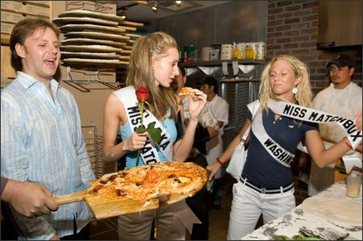 Kendra Lee Timm, Miss Washington, and Degen Kasper, Miss Alaska, show off their new sashes for creating the winning smiley face pizza creation.