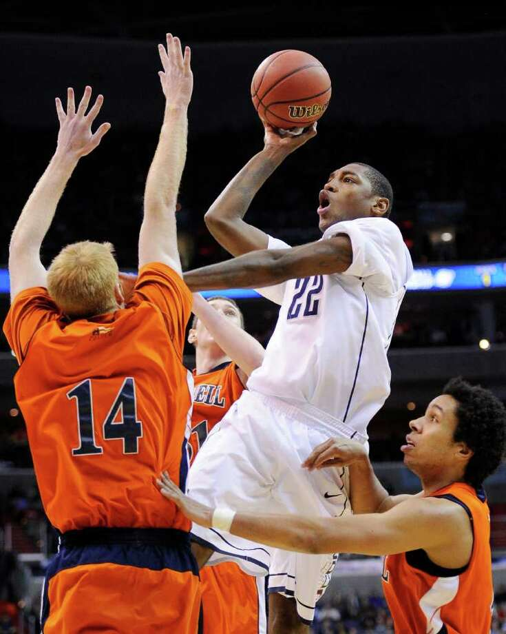 Connecticut forward Roscoe Smith shoots between Bucknell forward Joe Willman. left, and guard Bryson Johnson,right, during the second half of the West regional second round NCAA tournament college basketball game, Thursday, March 17, 2011, at the Verizon Center in Washington. (AP Photo/Nick Wass) Photo: AP