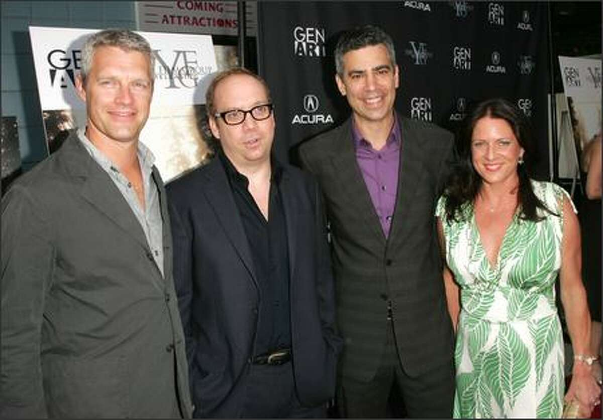 """From left to right: Writer/director Neil Burger, actor Paul Giamatti, producers Michael London and Cathy Schulman attend Yari Film Group's premiere of """"The Illusionist"""" at Chelsea West Cinemas Tuesday in New York City. (Getty Images/Peter Kramer)"""