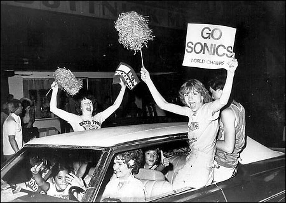 Sonics bring home the trophy, 1979: Basketball fans celebrate in Pioneer Square after the Seattle SuperSonics won the NBA Championship, giving the city its first - and so far, only - major professional sports championship. The Sonics earned a 4-1 series victory over the Washington Bullets on June 1, 97-93. Photo: Grant M. Haller, Seattle Post-Intelligencer
