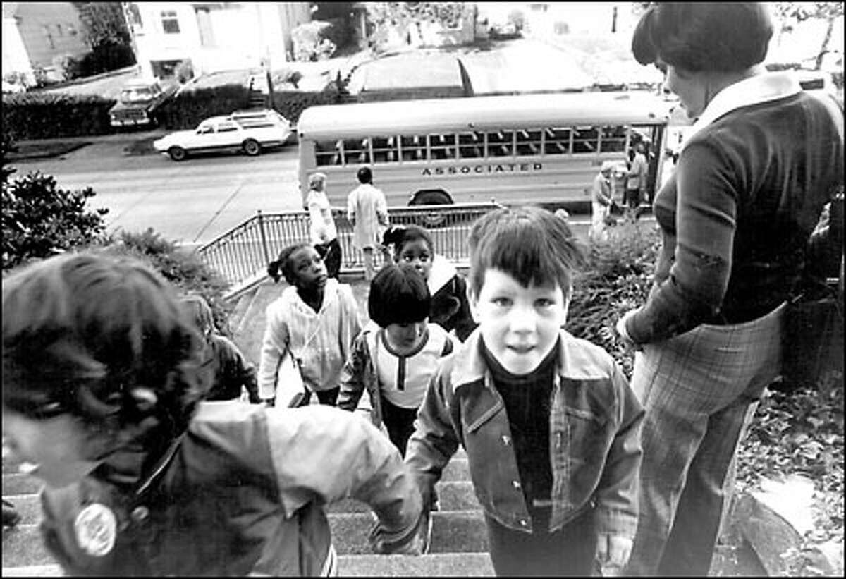 School desegregation begins, 1978: Students arrive at Magnolia Elementary School after a bus ride from Dearborn Park Elementary as the school desegregation program in Seattle got under way in September 1978.