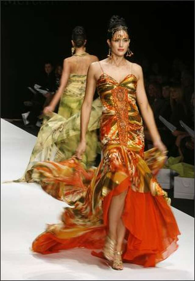 A model walks the runway during the Sue Wong fashion show during Mercedes Benz Fashion Week at Smashbox Studios in Culver City, Calif., on Sunday, Oct. 15, 2006. (AP Photo/Matt Sayles)