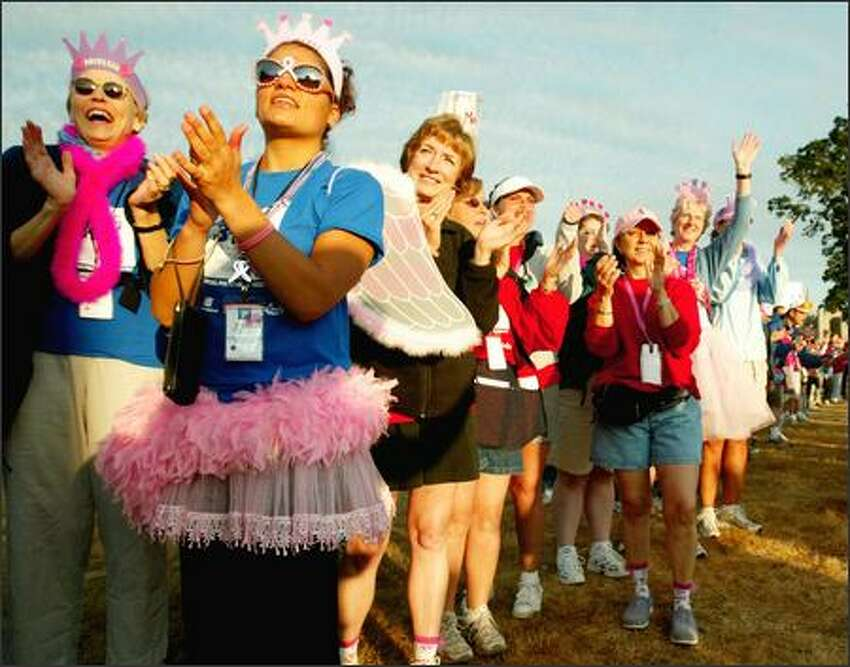 Before beginning their own walk, participants in the Breast Cancer 3-Day, 60-mile fund raiser cheer on the 2,700 walkers as they leave Marymoor Park on Friday.
