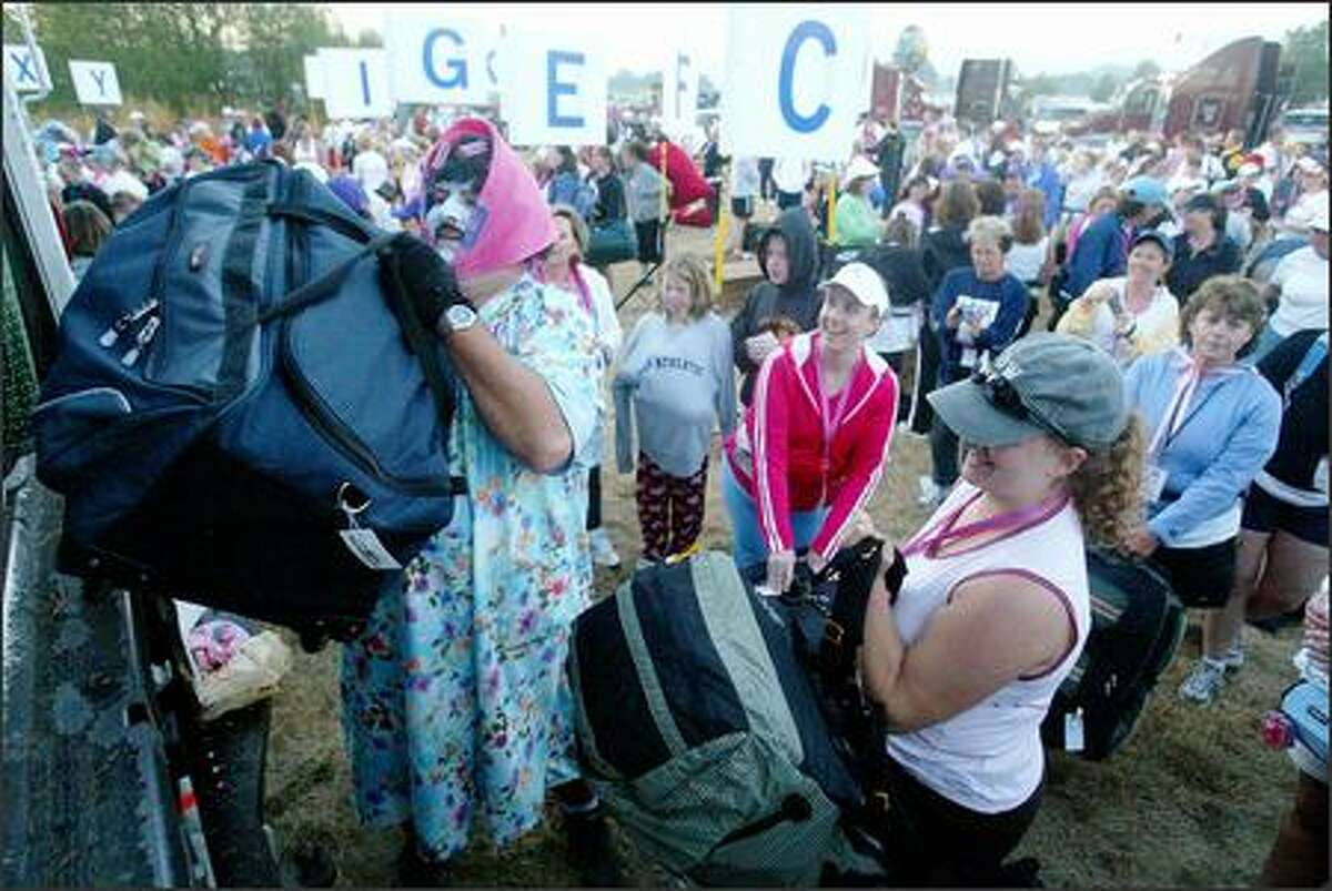 Dennis Judd was in charge of packing gear for the 2,700 women and men participating in the Breast Cancer 3-Day event, a 60-mile, 3-day walk to benefit breast cancer research. Walkers raised $6.9 million. The 3 day event started Friday in Marymoor Park and ends Sunday near Husky Stadium.