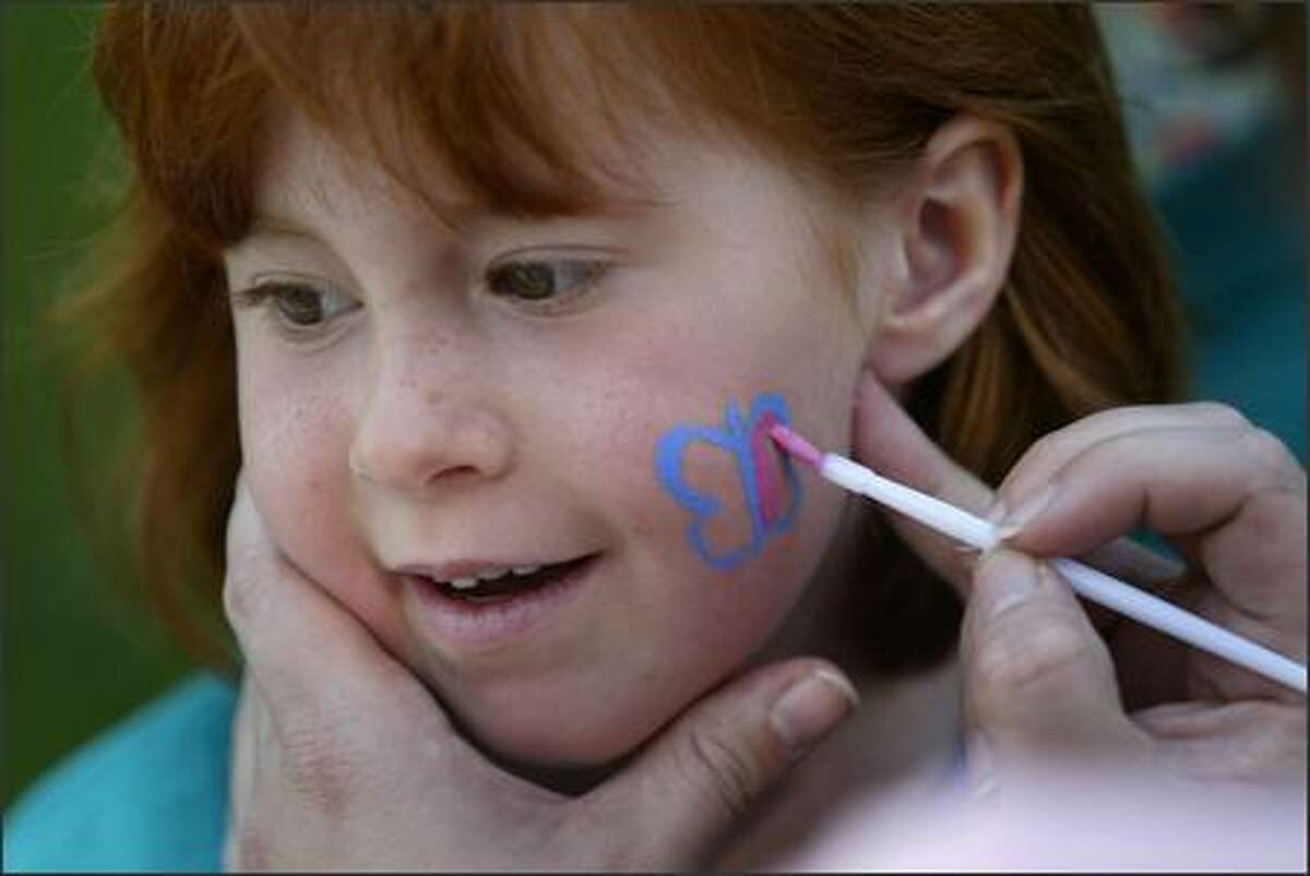 Hannah Leigh has her face painted at the Prader-Willi walkathon on Aug. 26 in Bothell. Hannah has Prader-Willi, a genetic disorder.