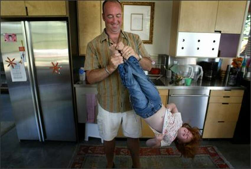 Hannah has fun with her dad Rob Rose-Leigh on Aug. 7. Hannah started kindergarten on Wednesday. Her parents searched for the perfect school for the youngster who has a genetic disorder.