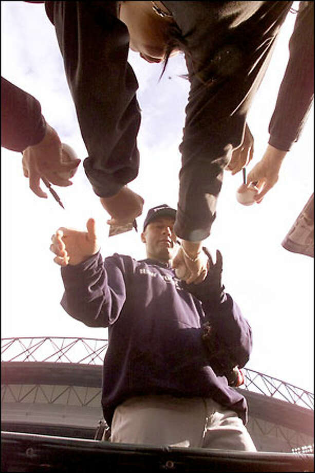Derek Jeter signs autographs at Safeco Field before Game 1. Photo: Mike Urban, Seattle Post-Intelligencer