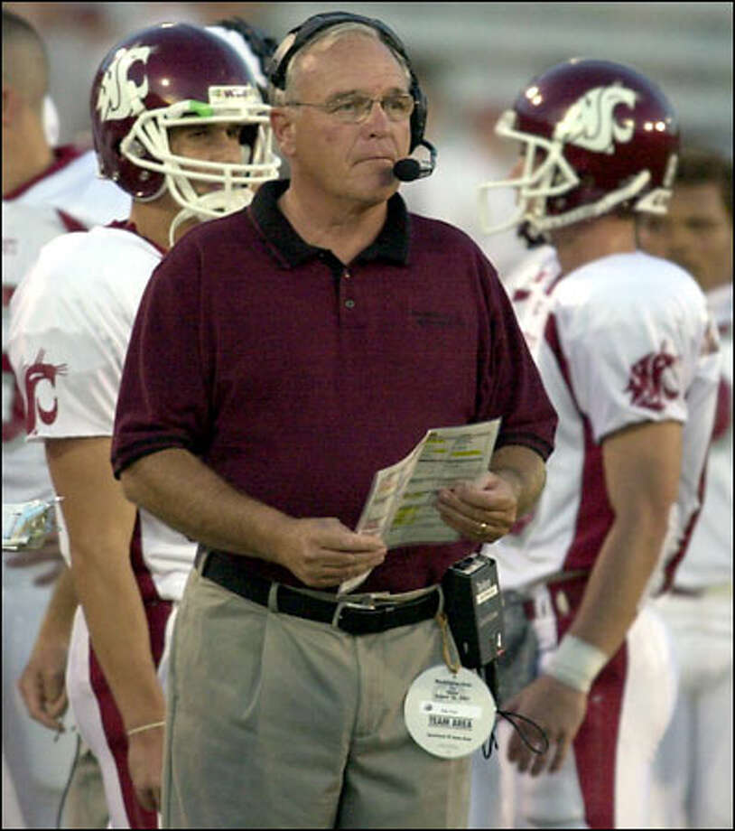 """No doubt another of Mike Price's contract perks at WSU is that super-huge """"Team Area"""" sideline pass he gets to wear. Photo: Associated Press"""